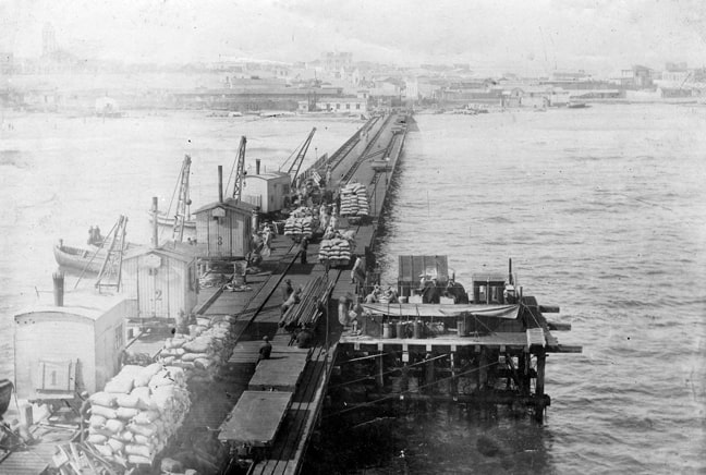 The wooden jetty with cranes and railway tracks.  Source: National Archives