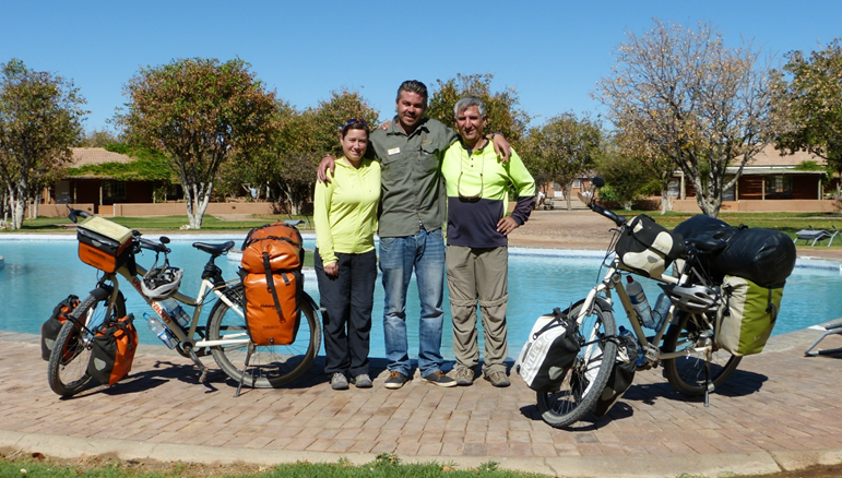 The Alpays with our DML Lodge Manager Phillip in front of the pool