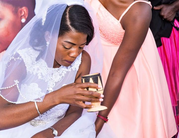 Bride drinking omalodu, Namibia