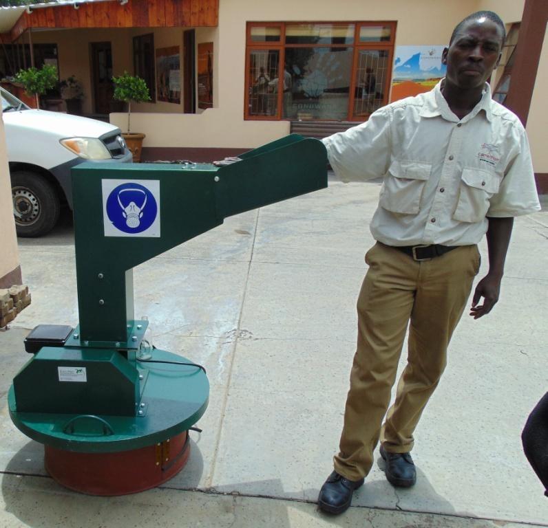 A Gondwana staff member with a new glass crushing machine