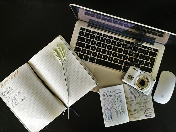 Laptop, Passport, Camera and Journal