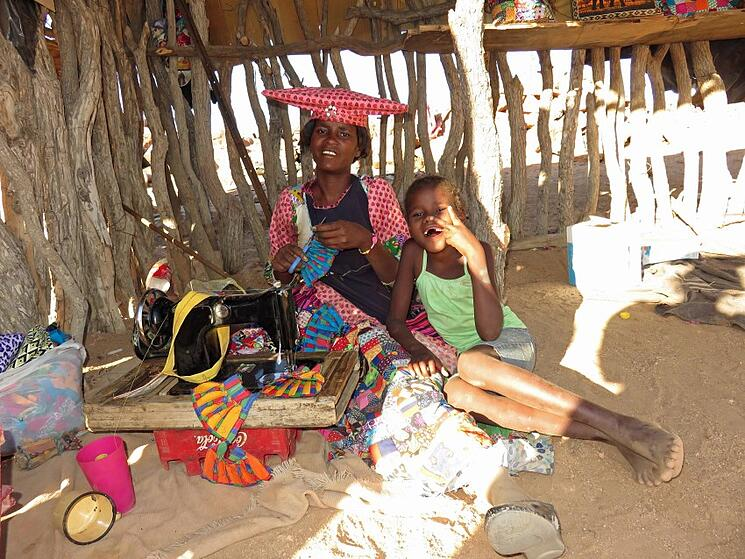 """""""Herero women patiently sew miniature dresses for their immaculate dolls"""""""