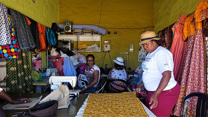 Sewing clothes at Single Quarters, Windhoek, Namibia