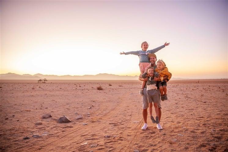 Family enjoying the sunset