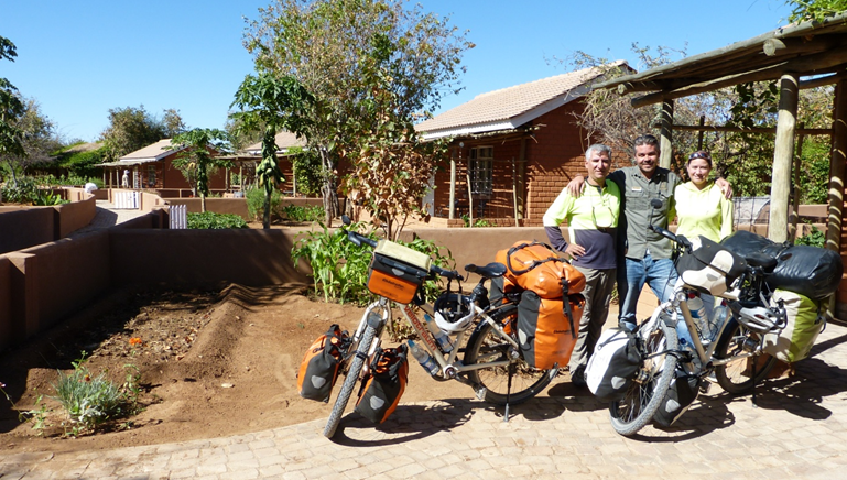The Alpays with our DML Lodge Manager Phillip in front of the gardens