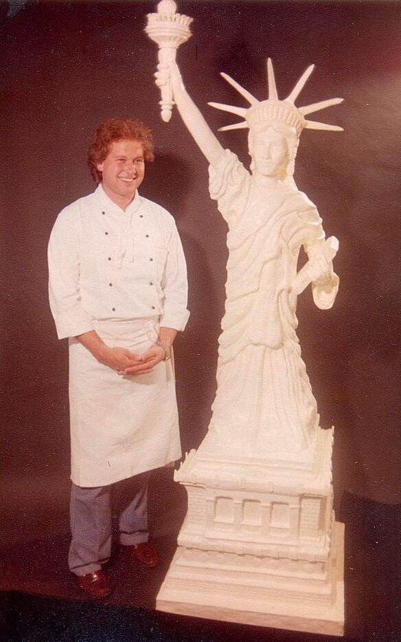 Joe Gross in the 70s with one of his butter sculptures shaped by hand.