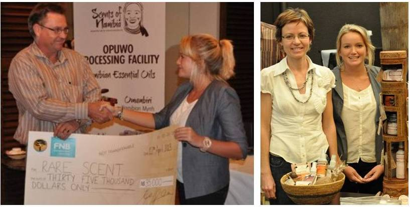 The winners receving the cheque and showcasing their products